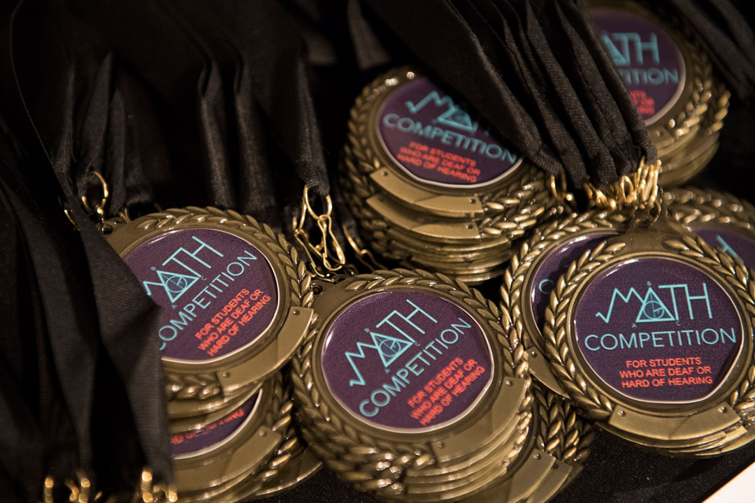 collection of math competition medals.