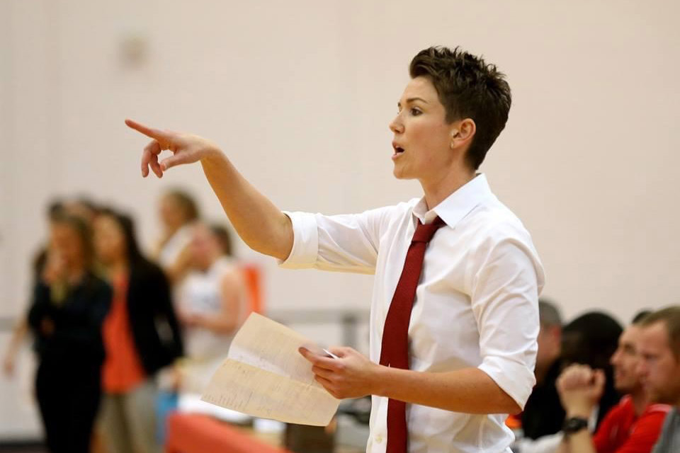 women's basketball coach calling out a play.