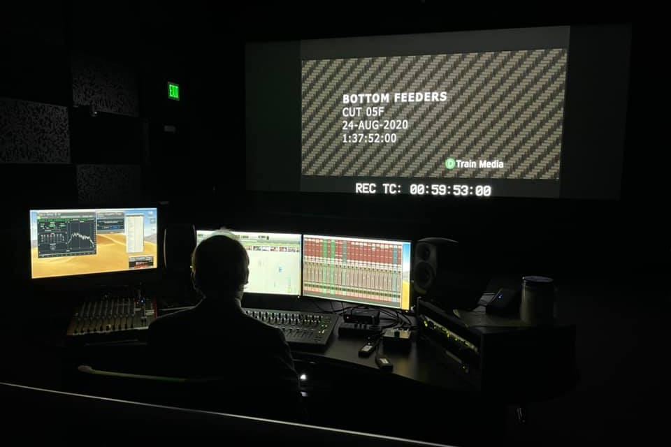 Dave Sluberski edits the sound for the film Bottom Feeders in the sound mixing theater in MAGIC Spell Studios.
