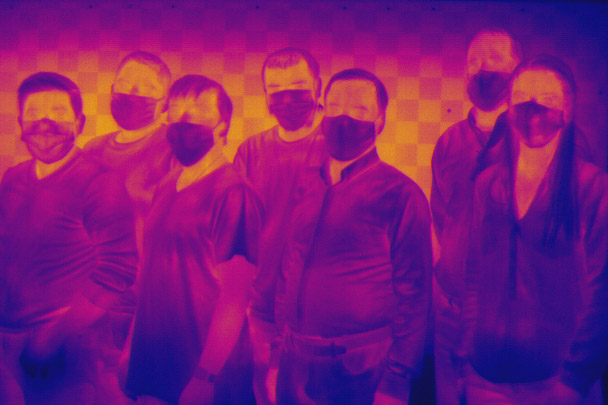 a thermal imaging photo of a team of researchers.