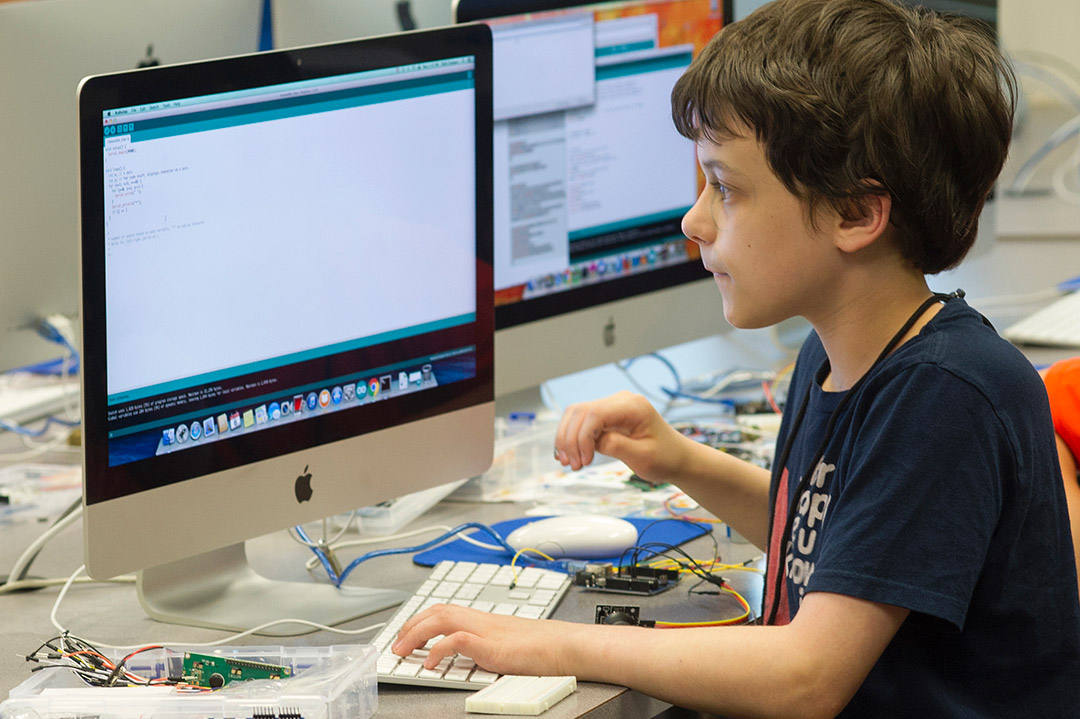 child working on a computer.