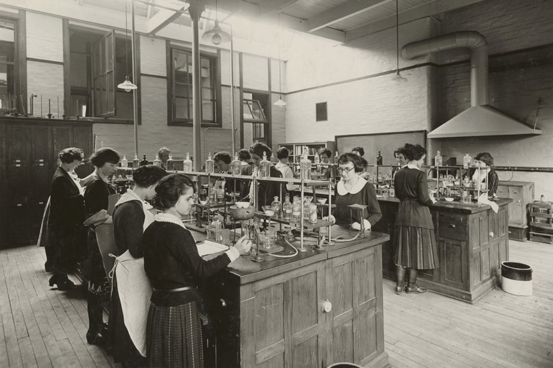 students working in a science lab around 1900-1920.