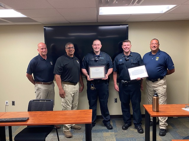 Five public safety officers with certificates