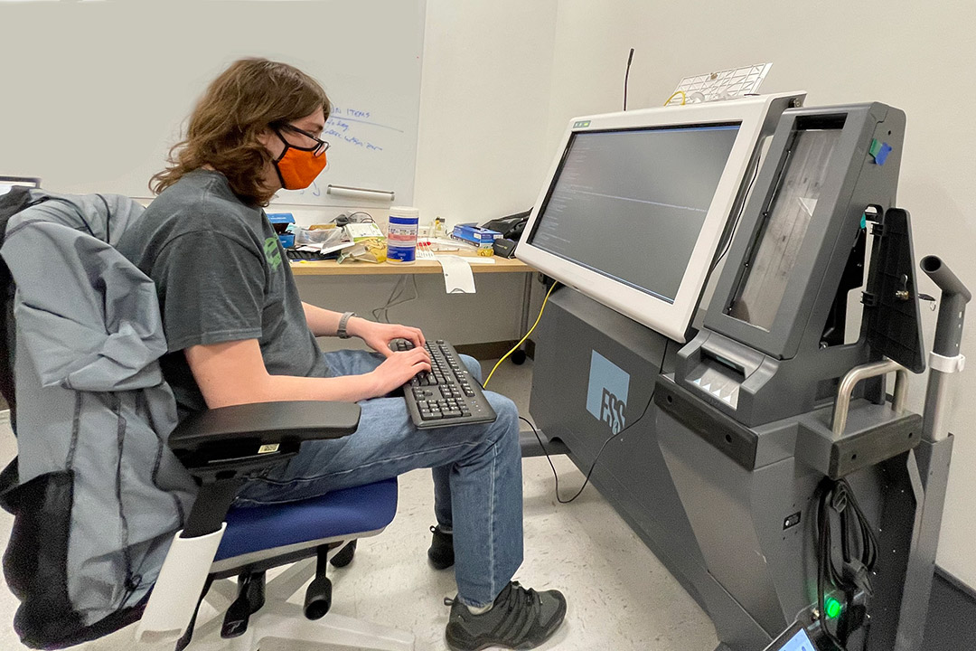 student using a computer voting machine.