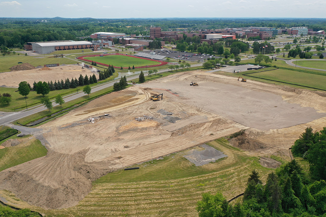aerial view of construction of a track and baseball complex.
