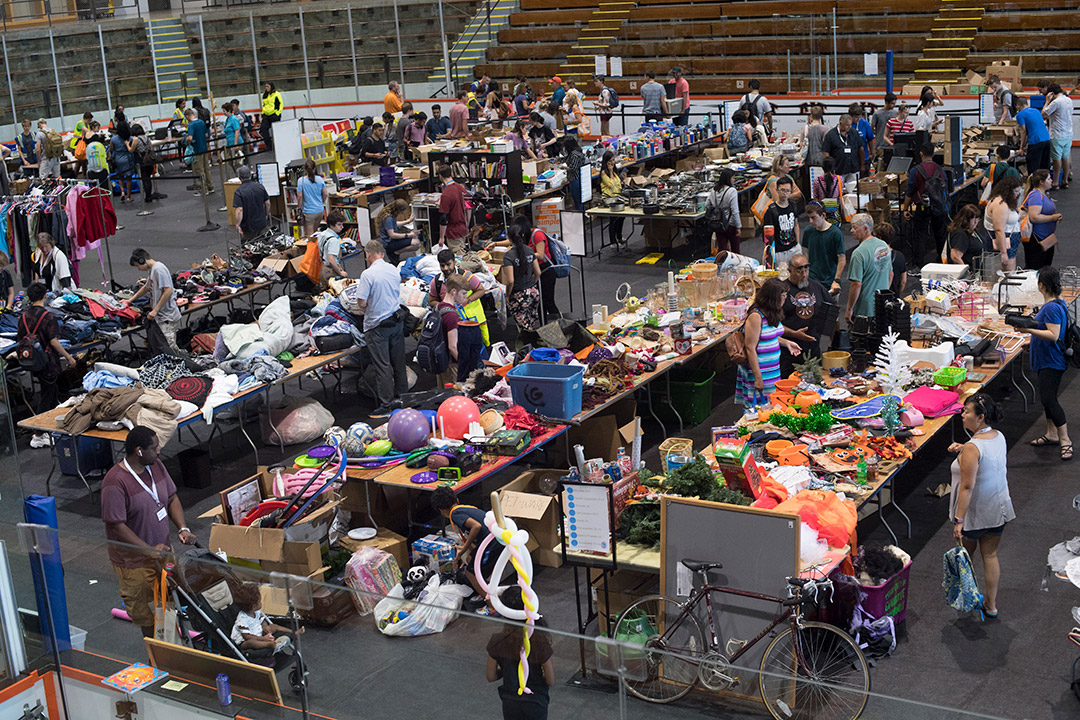 ice arena filled with people shopping for used goods.
