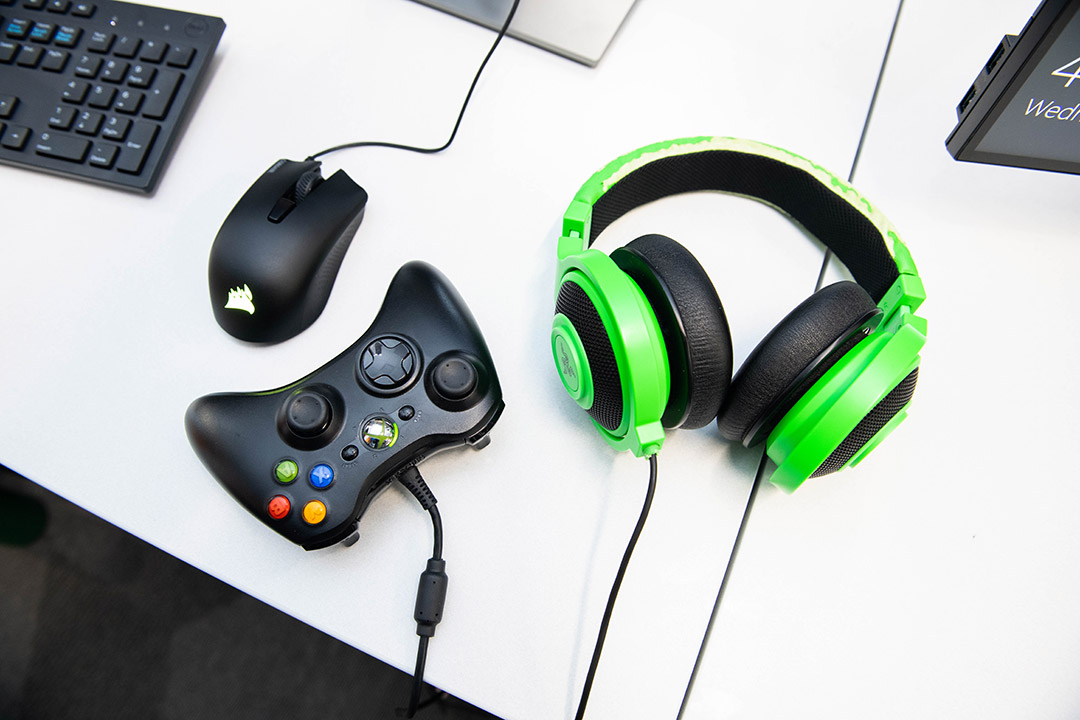 computer mouse, Xbox controller, and headphones.