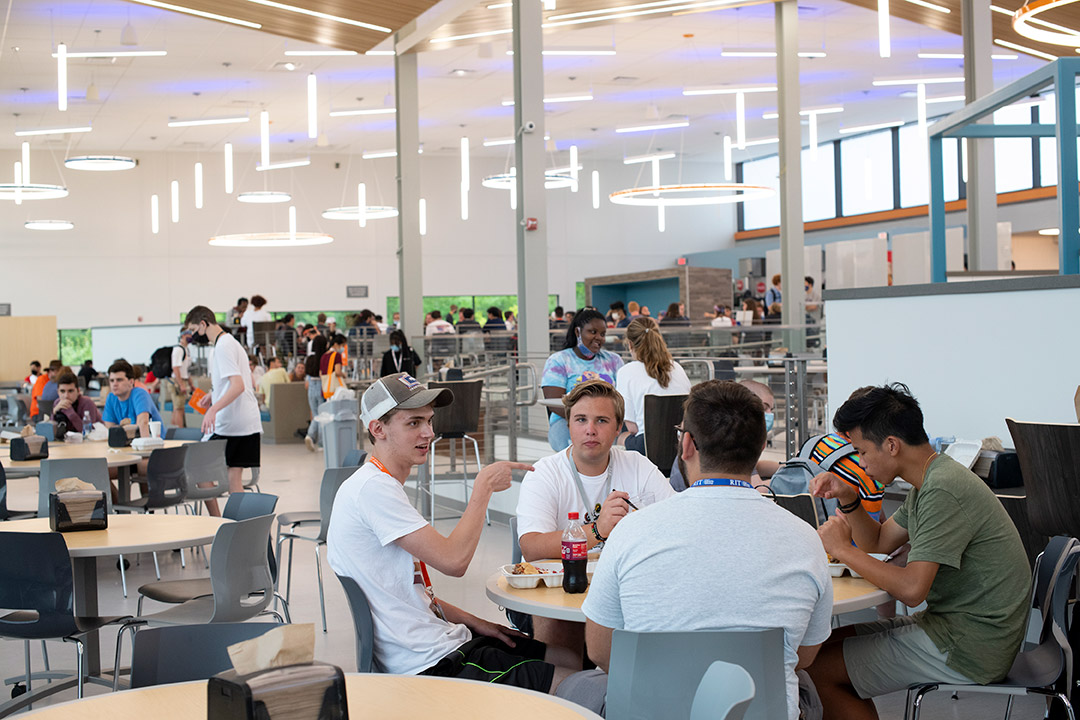 students eating in a renovated dining hall.