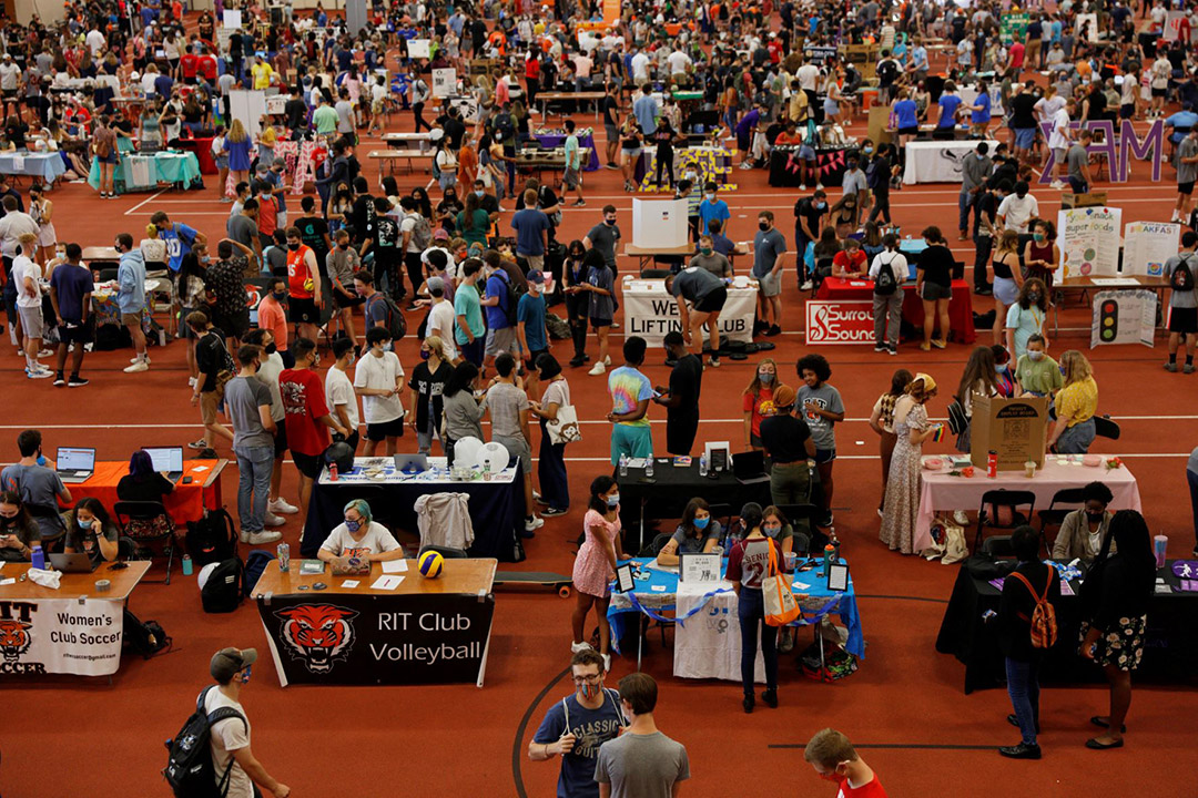 crowds of students visiting tables representing RIT's clubs.