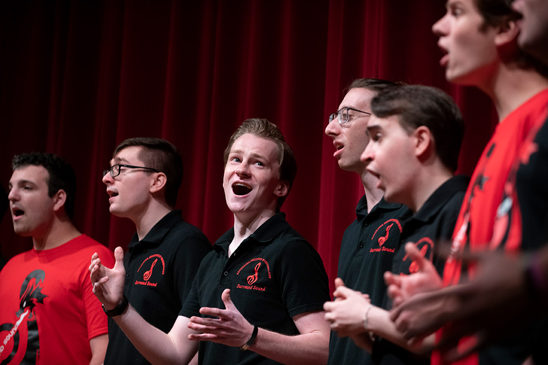 six students singing in an a cappella group.