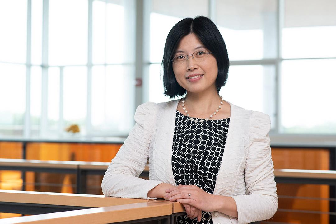 environmental portrait of professor Guiping Hu.
