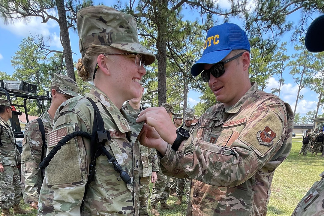 ROTC cadet receiving insignia for the Professional Officer Course.