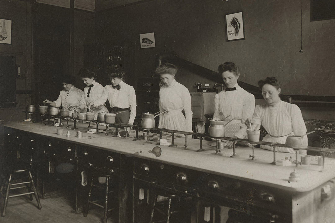 historic photo of women in a cooking lab.