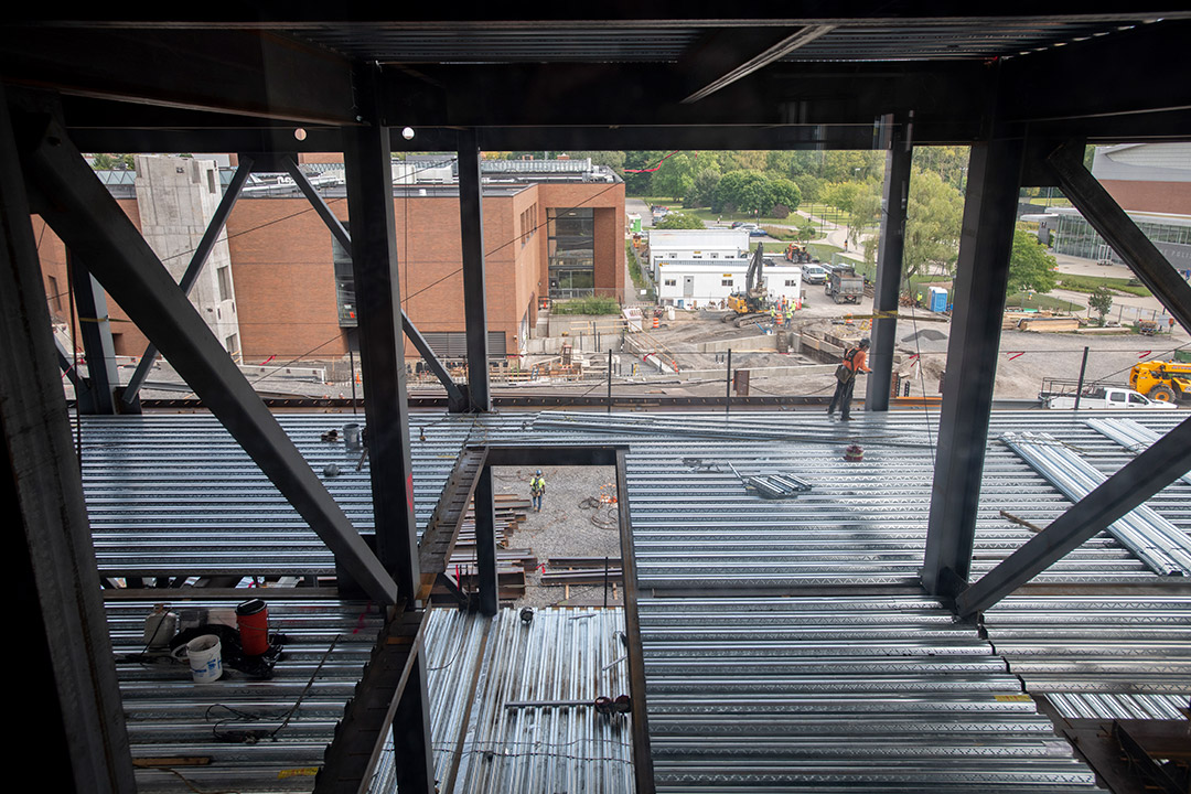 construction project with steel beams and corrugated metal.