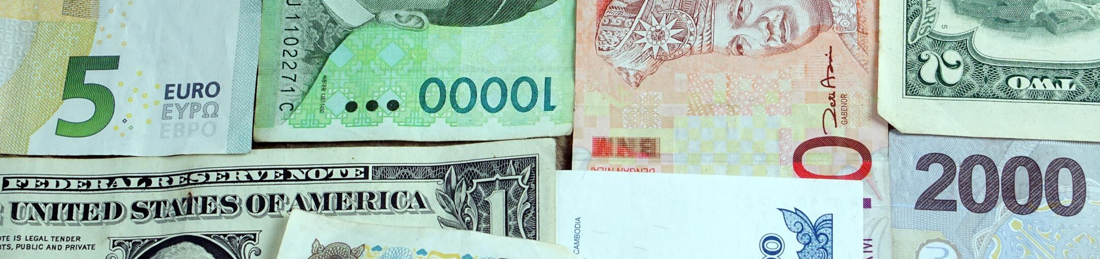 Close up of different paper currencies.