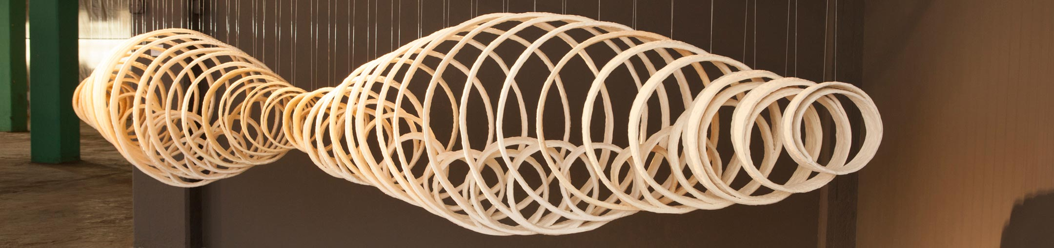 A hanging sculpture of concentric ceramic rings