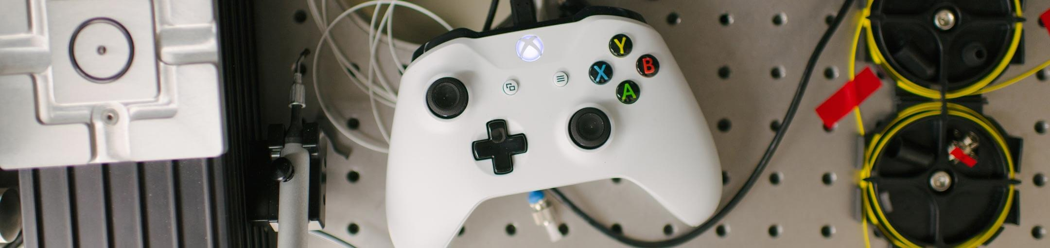 Close up of white game controller.