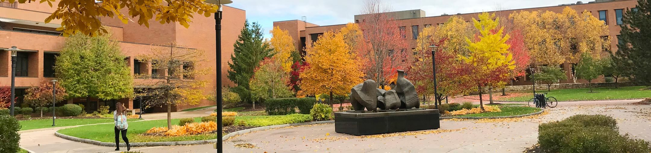 A large outdoor sculpture on campus during Autumn.