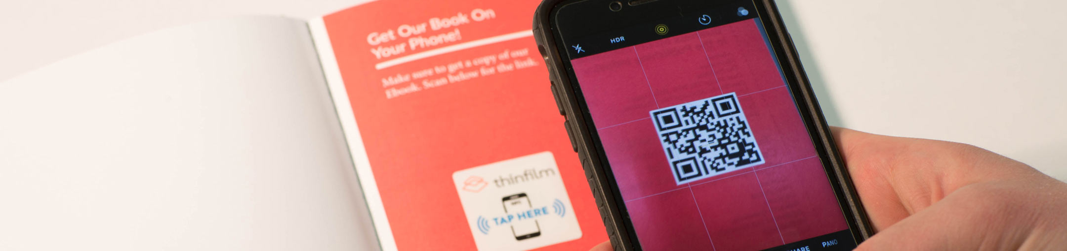 Close up of a phone scanning a QR code.