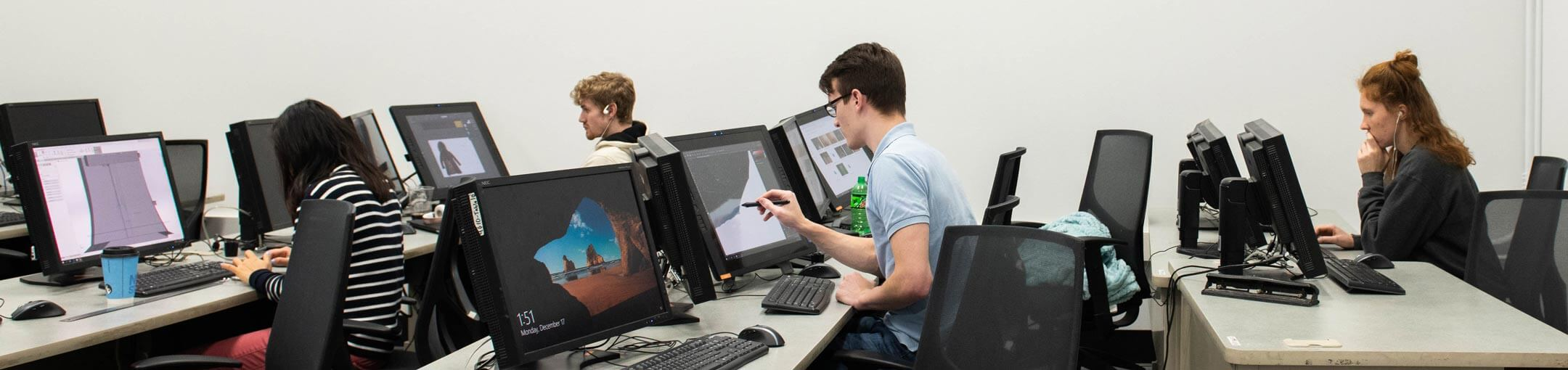 Students in computer lab using various design programs.