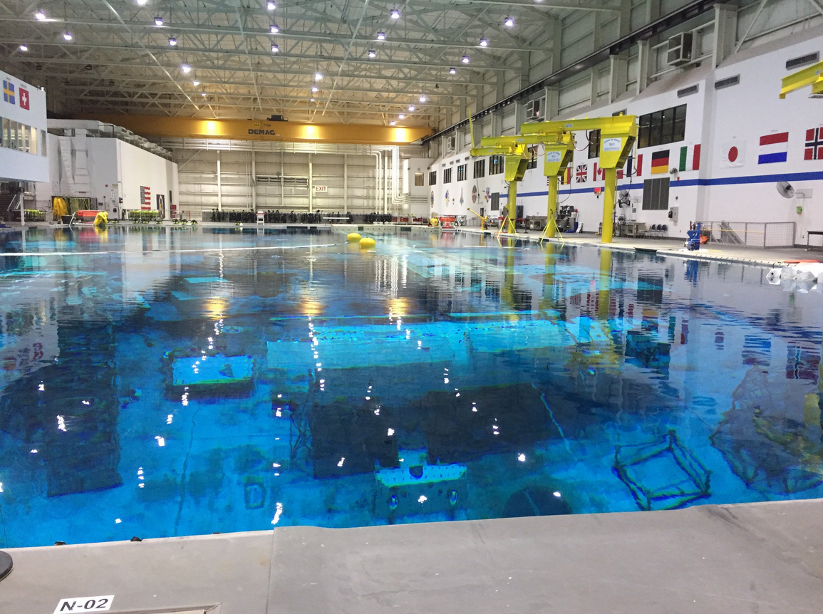 Large roomwith 40-foot deep pool containing equipment for astronauts to train with