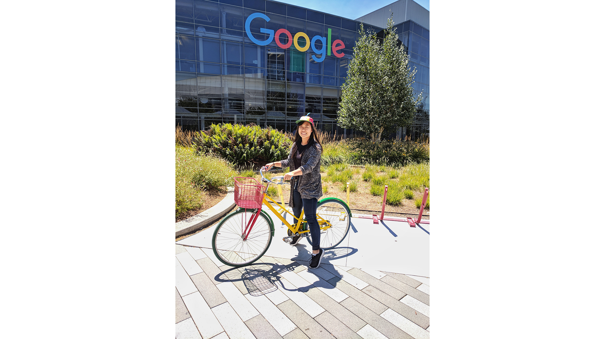 Ethelia Lung on a bike in front of Google