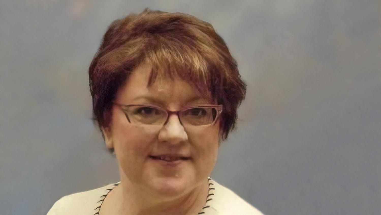 Portrait of Linda Marks on grayish background