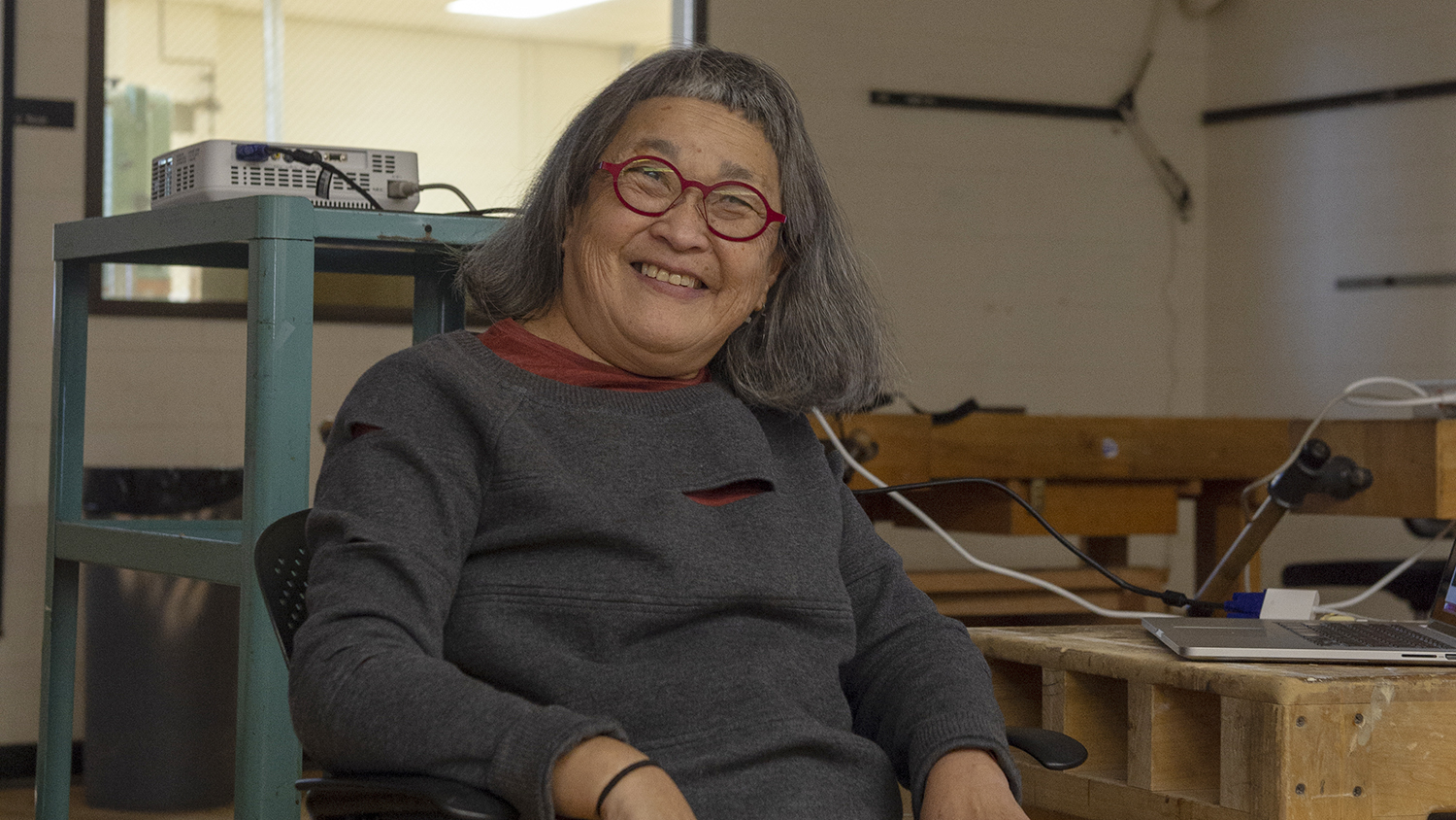 Wendy Maruyama, a pioneering female artist, in RIT's furniture design studio during a campus visit in 2018.