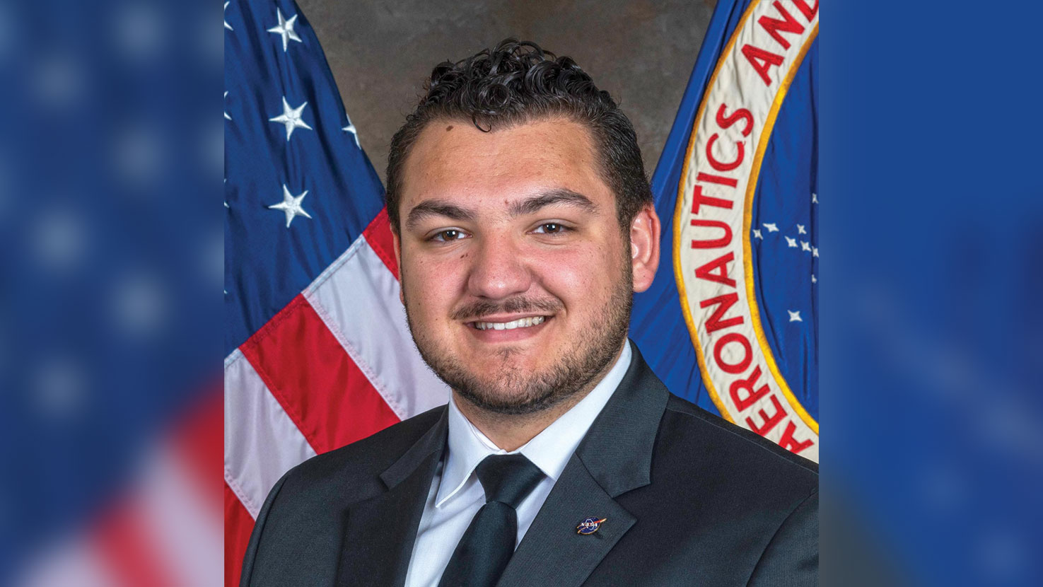 A portrait of Bailey Reid in front of US and NASA flags.