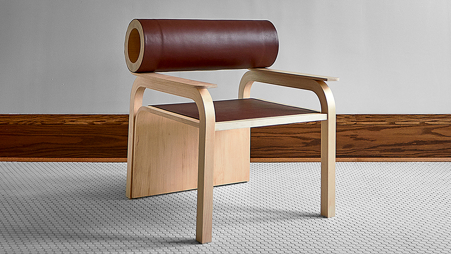 A chair design with a cylinder-shaped back support.