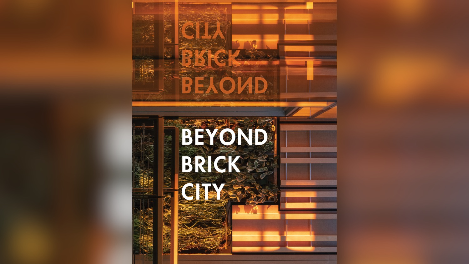 "An orange-tinted photo with the words ""Beyond Brick City."""