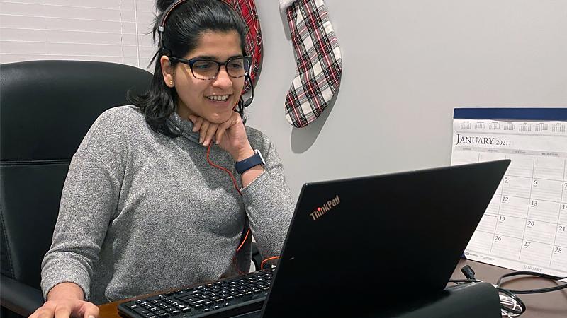 Shivani Phadke sitting in front of her laptop