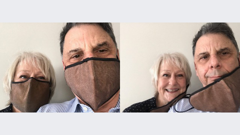 Ken Reed and his wife wearing masks